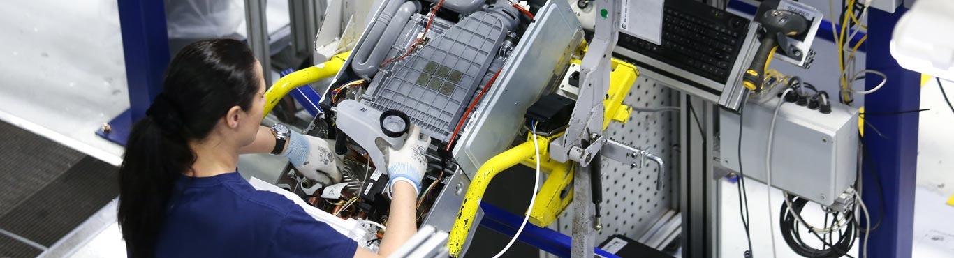 Overhead photo of an engineer assembling a boiler.