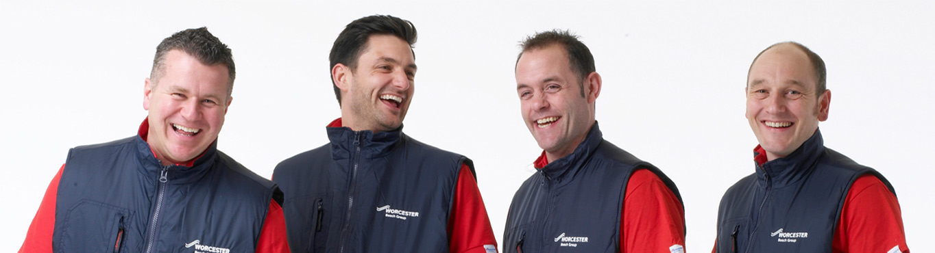 Four installers standing side by side laughing
